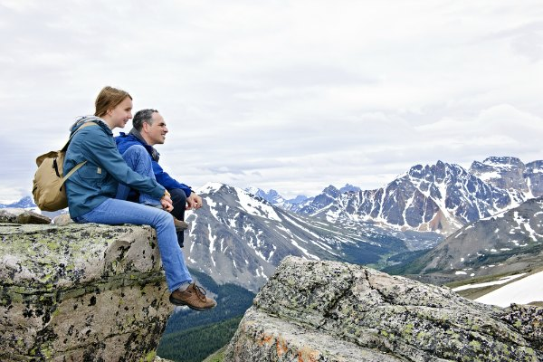 Father and daughter in mountains
